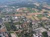 Meyrin au premier plan. A gauche le CERN et à droite le bois Tollot et le Bois de  Serves